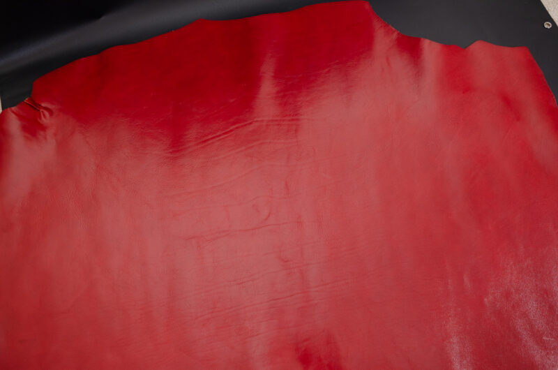 red vachetta leather